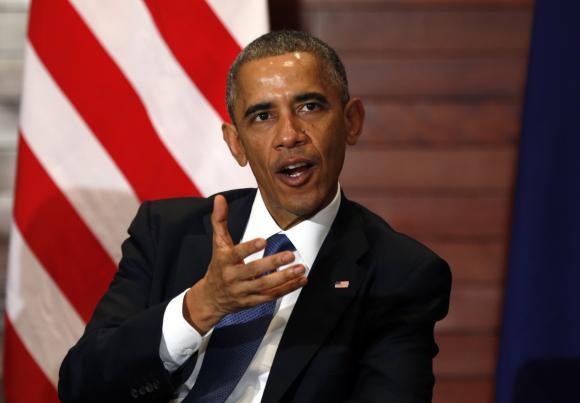U.S. President Barack Obama speaks during his meeting with Australian Prime Minister Tony Abbott in Beijing