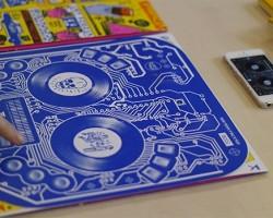Interactive album artwork doubles as a DJ controller