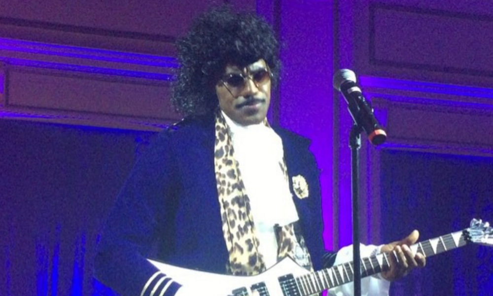 Photo of LeBron James dresses up as Prince for Halloween + Sings 'Purple Rain'