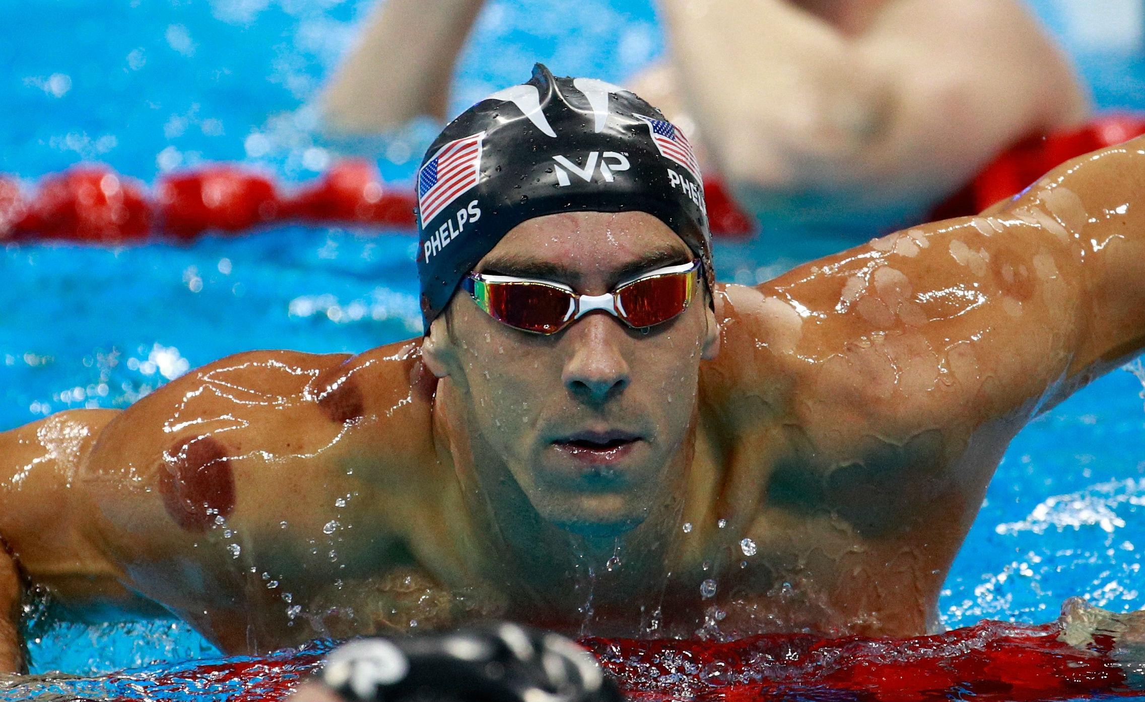 Photo of Michael Phelps Takes 2 Gold Medals on Tuesday