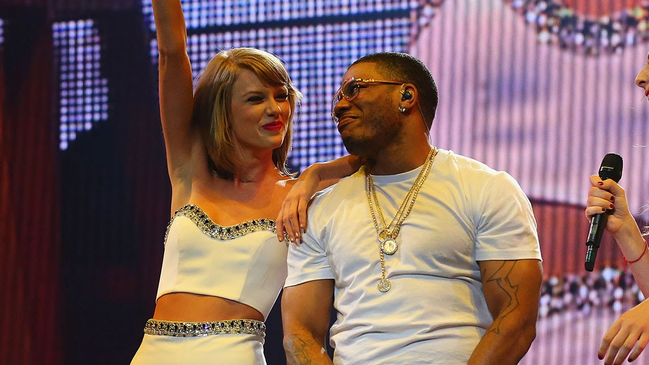Photo of Taylor Swift and Nelly take the stage together in the Hamptons